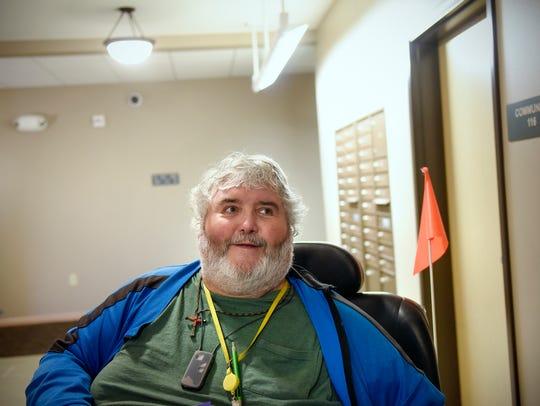 Veteran Mark Schotl smiles as he talks about his new