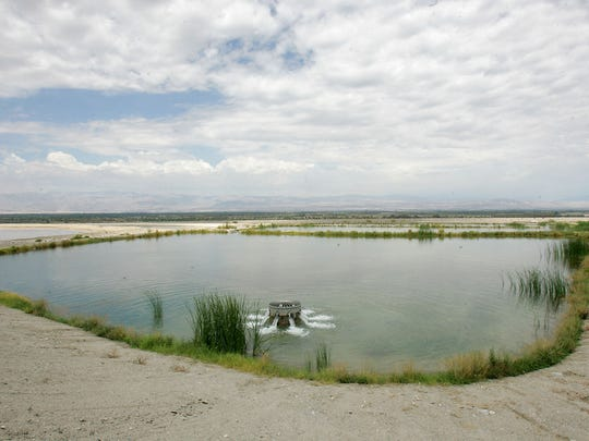 Water flows into a percolation pond at the Thomas E. Levy Groundwater Replenishment Facility in La Quinta.