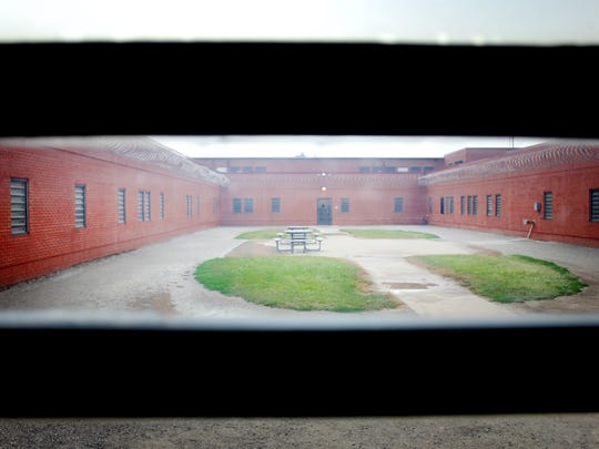 This 2013 file photo shows a look through the window of a central activity yard at the Iowa Medical Classification Center, also known as Oakdale prison.