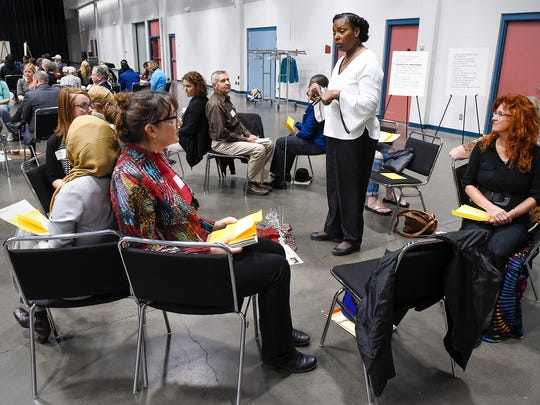 Debra Leigh instructs her group for a listen exercise during Conversations On Race Tuesday, Oct. 17, at the River's Edge Convention Center.