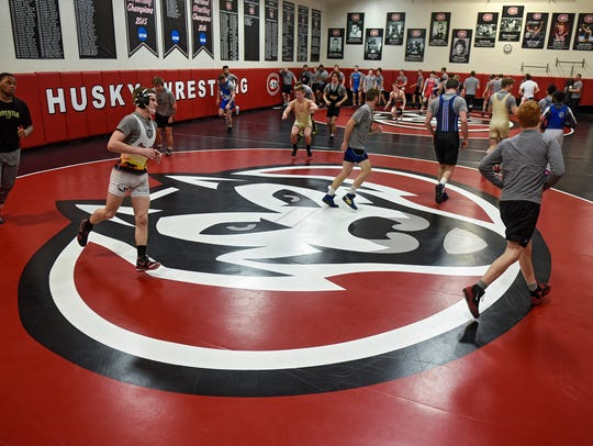 St. Cloud State wrestling team members practice on