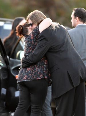 Friends and family console each other after the funeral of country star Mel Tillis on Monday, Nov. 27, 2017, at Mount Hermon Baptist Church in Clarksville, Tenn. Tillis, one of country music's most beloved entertainers, was a member of the Country Music Hall of Fame and Grand Ole Opry.
