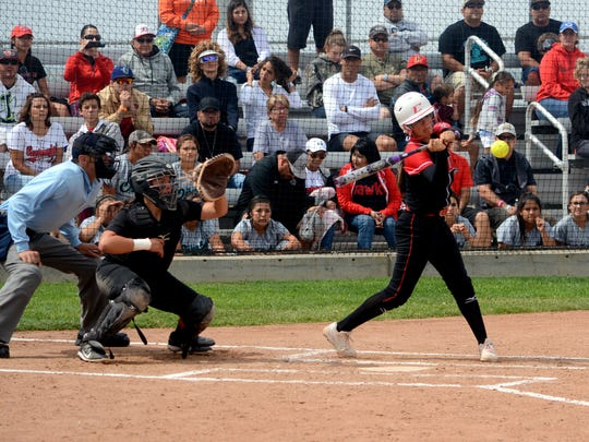 Centennial's Juliana Vidal makes contact at the plate
