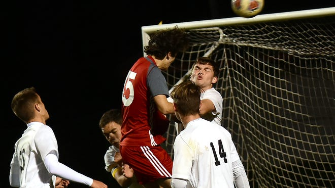 Crestwood's Dominic Desjardins and Garfield's Kage Callahan both go for a header during a corner kick last season.