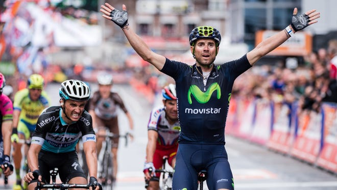 Alejandro Valverde of the Movistar team, right, celebrates as he crosses the finish line to win the Liege-Bastogne-Liege cycling classic in Ans, Belgium on April 26, 2015.