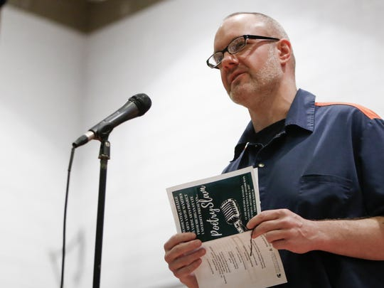 Prison inmate Michael Duthler reads a poem Tuesday,
