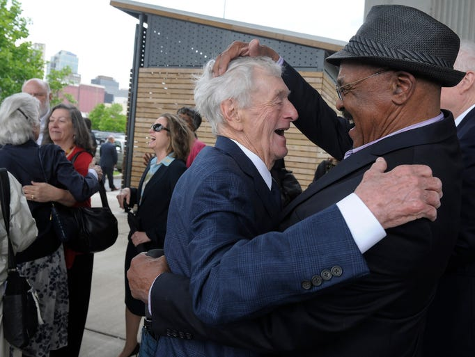 John Seigenthaler gets a greeting from councilman Walter Hunt at the ceremony held to rename the Shelby Avenue pedestrian bridge on Tuesday, April 29, 2014, in Nashville.