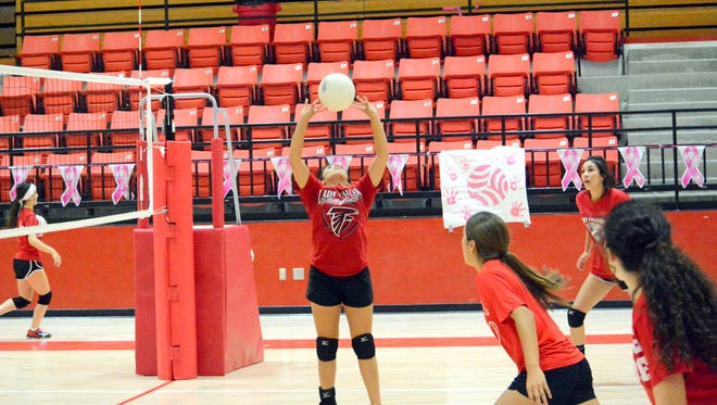 Loving's Cassandra Calderon passes the ball during Wednesday's practice. The Lady Falcons open District 4-3A competiton Saturday at Capitan.