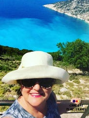 Linda Meyers takes a selfie in Greece. She and husband