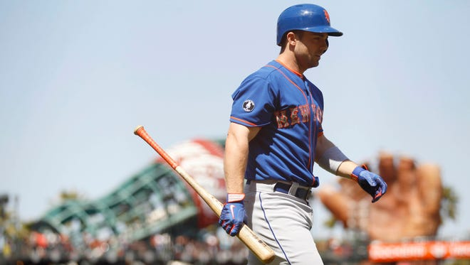 The Mets' David Wright walks towards the dugout after striking out against the San Francisco Giants during a pinch-hit appearance in the seventh inning at AT&T Park on Sunday. The Giants defeated the Mets 6-4.
