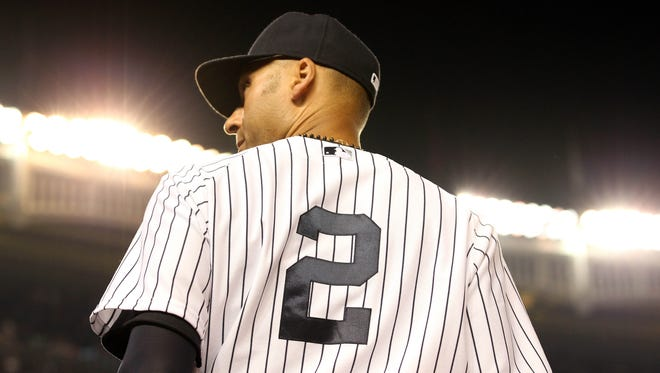 New York Yankees shortstop Derek Jeter takes the field against the Texas Rangers during the eighth inning Monday at Yankee Stadium.