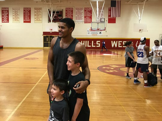 Detroit Pistons forward Tobias Harris poses with children who participated in his basketball camp in New York on Thursday, June 29, 2017.
