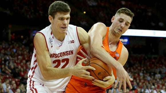 Ethan Happ and Syracuse's Tyler Lydon fight Tuesday for a loose ball in the first half at the Kohl Center.