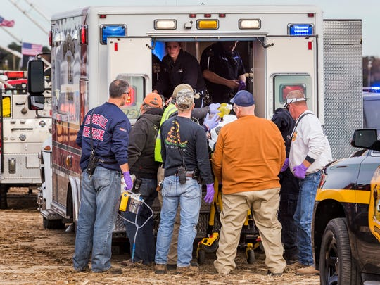 Paramedics take an injured Suzanne Dakessian to an ambulance after a piece of metal flew off of an air cannon, striking her in the head, at the World Championship Punkin Chunkin in Bridgeville in 2016.