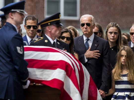 The Biden family gathers as Beau Biden's casket is brought into St. Anthony of Padua Catholic Church in Wilmington on June 6, 2015.