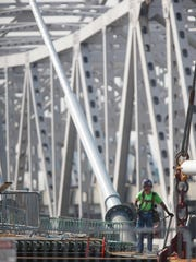 Though workmen are still out there now, the new downtown bridge will be open to pedestrians Dec. 5.