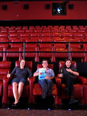 A photo illustration for a story on the Xscape Theatres, where you can enjoy an alcoholic beverage with your movie. Left to right; Liz Kramer, C-J arts reporter, Jeffrey Lee Puckett, C-J music critic and Bailey Loosemore, C-J beverage writer. Oct. 14, 2015