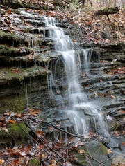 A small stream flows down an rock outcrop in the recently acquired Cave Hollow area near Bernheim Forest with the help of the Kentucky Heritage Land Conservation Fund.  Nov. 10, 2015