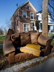 Abandoned furniture sits at the curb in front of a home on South 22nd Street. The majority of residents polled in a University of Louisville survey say they worry more over nuisances than crime.