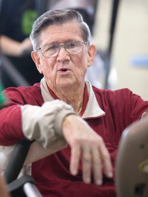 Glendon Bassett visits with Tamara Hess-Adams team leader of the fitness center at the Family YMCA in Hot Springs, Ark., Dec. 22, 2015. Bassett, a retired chemical engineer, says he can vouch for the teamwork approach Medicare is promoting. Earlier this year, a primary care team at SAMA Healthcare in El Dorado, Arkansas, prevented what Bassett feared would turn into an extended hospitalization. It started with a swollen leg.