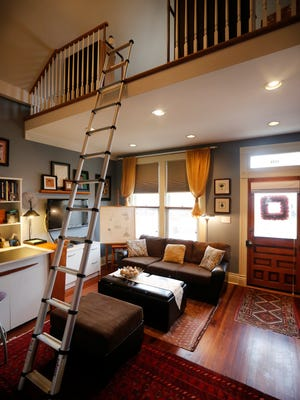 A ladder leads to to a loft in the front room of Karen Abney's home. Feb. 23, 2016