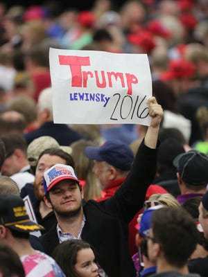A Donald Trump supporter held up a sign in support of the Presidential candidate, as well as Monica Lewinsky. March 1, 2016.