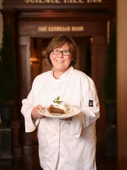 Science Hill Inn chef Ellen Gill McCarty holds a plate