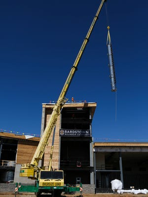 The 50-foot, custom made, 36-inch stainless steel Vendome Copper and Brass Works still is lifted in to the air above the Bardstown Bourbon Company facility Thursday morning. The state-of-the-art whiskey distillery is scheduled to begin production in Sept. 2016, offering visitors access and a transparent view of the distilling process, sometime in 2017. April. 14, 2016