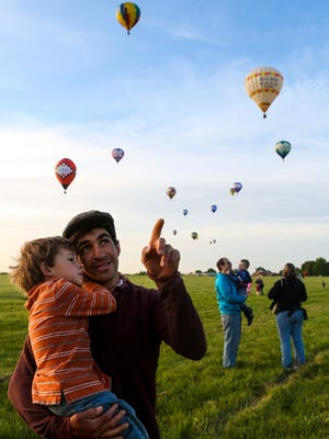 at the start of the Great Balloon Rush-Hour Race at Bowman Field on Friday morning. April 28, 2016