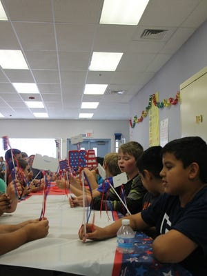 Fifth graders celebrated with a pizza party for finishing the Give Me Liberty Club.