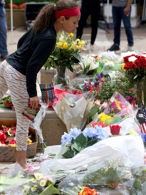 A makeshift memorial for boxing legend Muhammad Ali sits outside the The Muhammad Ali Center, a museum and cultural center in Louisville Saturday June 4, 2016. The former three-time heavyweight boxing champion and humanitarian died late Friday.