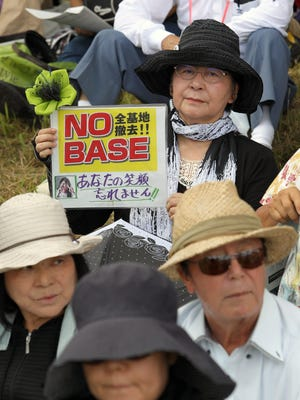 Demonstrators in Naha, capital of Okinawa island in southern Japan, gather June 19, 2016, to protest alleged crimes by U.S. military personnel and workers on the U.S. naval base in Okinawa.