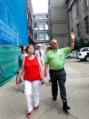 Jim Kruger blessed the government buildings in downtown Louisville. Kruger and his wife Jacqie, left, are travleing to each courthouse in the state and blessing them. July 18, 2016.