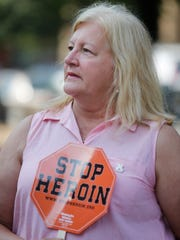Kathy Benish held a sign to stop the spread of herion use. She lost her son to a herion overdose in 2010. Benish was attending the Fed Up! Overdose Awareness Rally at Jefferson Square Park. Aug. 31, 2016.