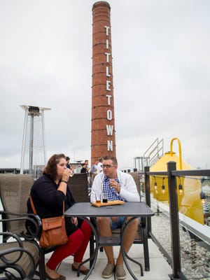 Amanda Abney and her husband Nathan, from Madison, Wis., sample a beer flight on the patio of Titletown Roof Tap, part of Titletown Brewing Co., in Green Bay, Wis., on August 20, 2016.