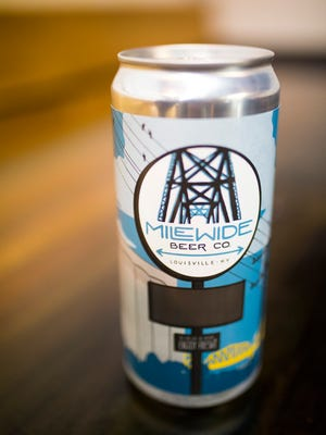 Mile Wide Beer Co. cans inside the new brewery, located behind Drakes, that is nearing an opening date. Nov. 16, 2016