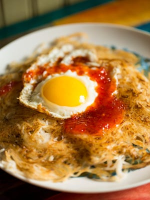 The Coconut Noodle Latke dish at Lydia House has rice noodles with coconut sauce and an egg. Nov. 17, 2016