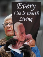 Margie Montgomery of Kentucky Right to Life held a sign during a Pro Life rally in front of Metro Hall, in Louisville.
