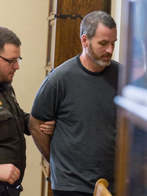 Kenneth Conrad is escorted from the courtroom by Deputy Joseph LeBreck after he was sentenced for first-degree sexual assault on March 15, 2017 in the Adams County Courthouse in Friendship, Wis.