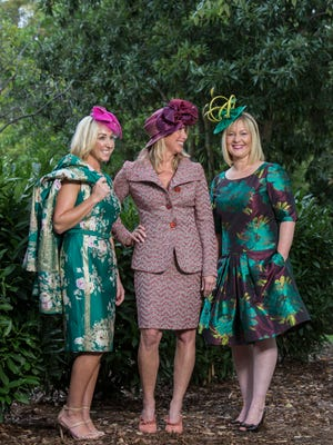 Melissa Jones, left, Trina O'Brien, center, and Caton Brader, right, modeled hats and dresses for this year's Breeders' Cup. Oct. 5, 2017.