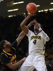 Iowa's Isaiah Moss draws a foul during the Hawkeyes' game against Grambling State at Carver-Hawkeye Arena on Thursday, Nov. 16, 2017.