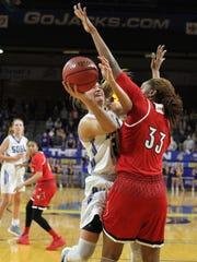 South Dakota State's Macy Miller tries to score on