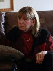 Teresa Mulhausen is pictured in son's condominium on