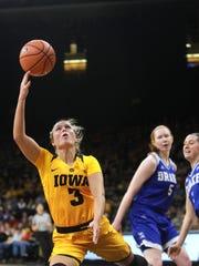 Iowa's Makenzie Meyer draws a foul as she takes a shot