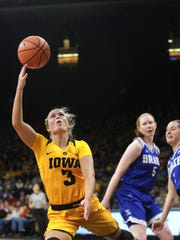 Iowa's Makenzie Meyer draws a foul as she takes a shot during the Hawkeyes' game against Drake at Carver-Hawkeye Arena on Thursday, Dec. 21, 2017.