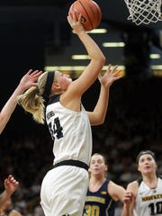 Iowa's Carly Mohns goes up for a shot during the Hawkeyes' game against Michigan at Carver-Hawkeye Arena on Sunday, Dec. 31, 2017.