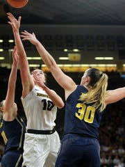 Iowa's Megan Gustafson takes a shot during the Hawkeyes' game against Michigan at Carver-Hawkeye Arena on Sunday, Dec. 31, 2017.
