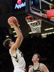 Iowa's Luka Garza goes up for a shot during the Hawkeyes' game against Michigan at Carver-Hawkeye Arena on Tuesday, Jan. 2, 2018.