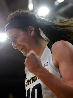 Iowa's Megan Gustafson celebrates a basket and a foul during the Hawkeyes' game against Purdue at Carver-Hawkeye Arena on Saturday, Jan. 13, 2018.