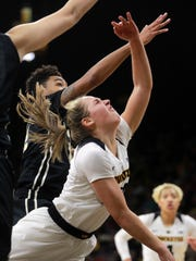 Iowa's Kathleen Doyle draws a foul during the Hawkeyes'